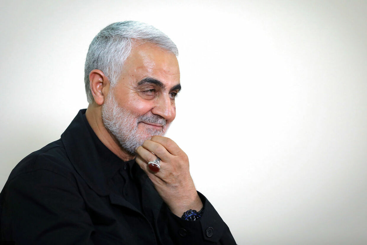 """(FILES) A file handout photo taken on October 01, 2019 shows Qasem Soleimani, Iranian Revolutionary Guards Corps (IRGC) Major General and commander of the Quds Force, wearing his trademark ring during an interview with members of the Iranian leader's bureau in Tehran. - Top Iranian commander Qasem Soleimani was killed in a US strike on Baghdad's international airport on January 3, 2020, Iraq's powerful Hashed al-Shaabi paramilitary force has said, in a dramatic escalation of tensions between Washington and Tehran. (Photo by - / KHAMENEI.IR / AFP) / === RESTRICTED TO EDITORIAL USE - MANDATORY CREDIT """"AFP PHOTO / HO / KHAMENEI.IR"""" - NO MARKETING NO ADVERTISING CAMPAIGNS - DISTRIBUTED AS A SERVICE TO CLIENTS ==="""