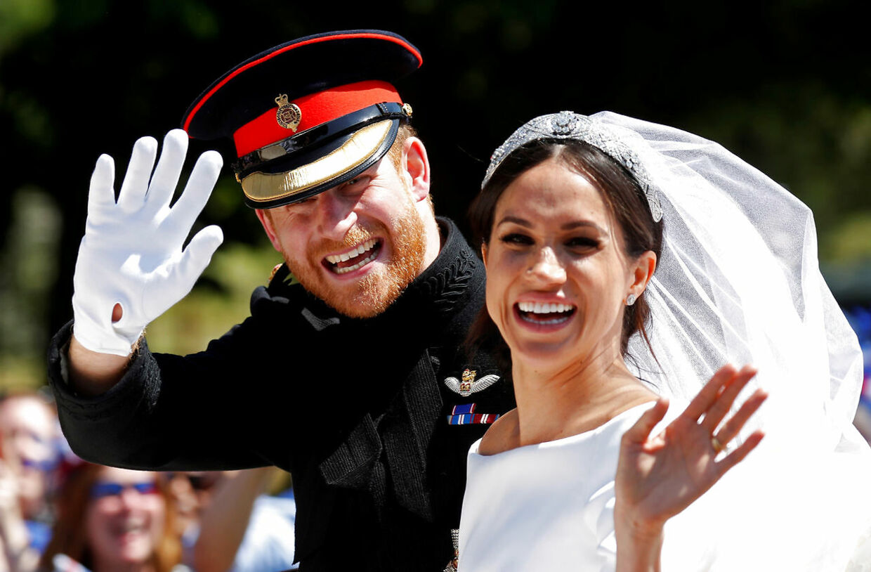 FILE PHOTO: Britain's Prince Harry and his wife Meghan wave as they ride a horse-drawn carriage after their wedding ceremony at St George's Chapel in Windsor Castle in Windsor, Britain, May 19, 2018. REUTERS/Damir Sagolj/File Photo