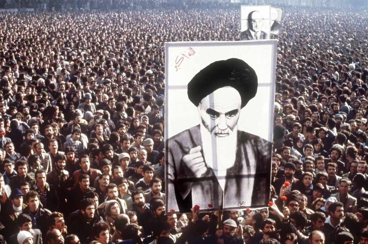 (FILES) In this file photo taken on January 01, 1979, Iranian demonstrators hold a poster of Ayatollah Ruhollah Khomeini in January 1979, during a demonstration in Teheran against the Shah. - On January 16, 1979, Iran's pro-Western Shah Mohammad Reza Pahlavi went into exile, ending 2, 500 years of monarchy. It was the end of a nearly four-decade reign and a pivotal moment in the revolution that installed an Islamic republic and rocked the Middle East. After stays in several countries, the shah ended up in Cairo, where he died on July 27, 1980. (Photo by - / AFP)