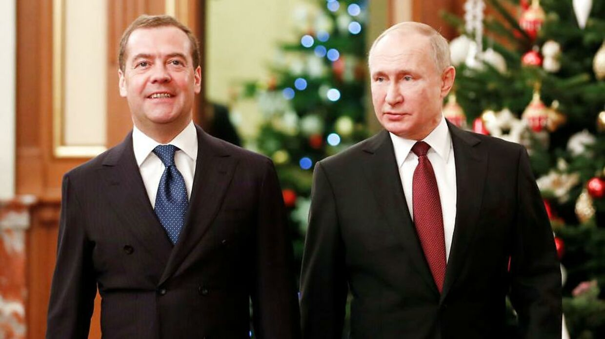 Russian President Vladimir Putin and Prime Minister Dmitry Medvedev walk past a Christmas tree before a meeting with members of the government in Moscow, Russia December 25, 2019. Sputnik/Dmitry Astakhov/Pool via REUTERS ATTENTION EDITORS - THIS IMAGE WAS PROVIDED BY A THIRD PARTY.