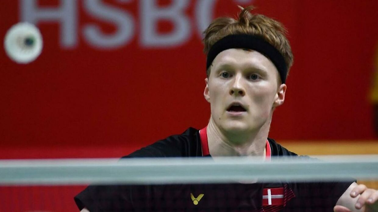 Anders Antonsen of Denmark hits a return to Lee Cheuk-yiu of Hong Kong during their men's singles semi-final match at the Indonesia Masters badminton tournament in Jakarta on January 18, 2020. (Photo by ADEK BERRY / AFP)