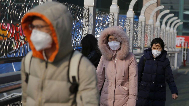 Overalt i Kina bærer folk masker for at beskytte sig mod smitte.