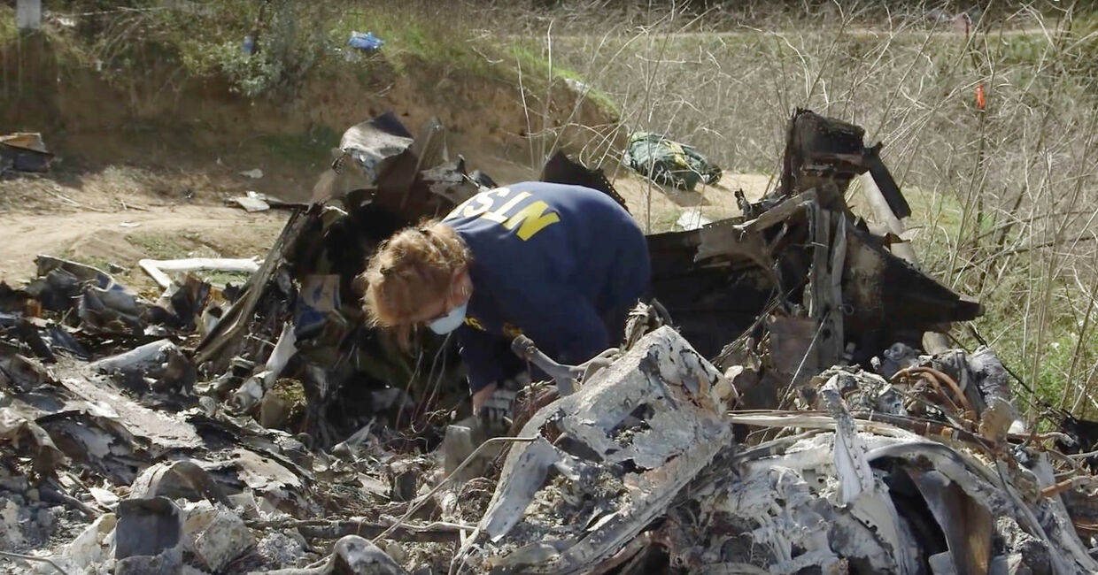 An investigator works at the site of the helicopter crash that killed Kobe Bryant and eight others in a screen grab taken in Calabasas, California, U.S. January 27, 2020 and released by the National Transportation Safety Board. NTSB/Handout via REUTERS THIS IMAGE HAS BEEN SUPPLIED BY A THIRD PARTY.