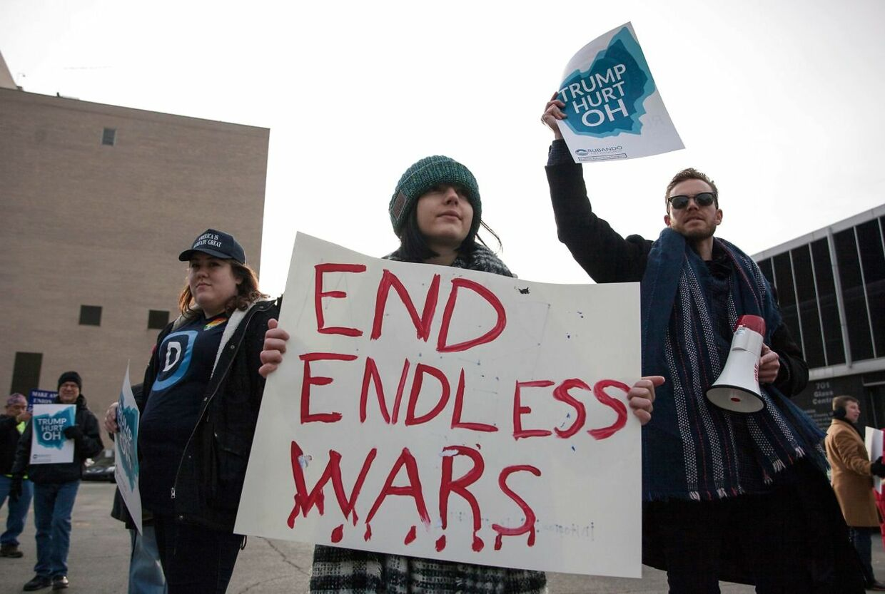 Protesters gather near the Huntington Center in Toledo, Ohio January 9, 2020 where U.S. President Donald Trump is holding his first campaign rally of the year. - Protesters gathered to protest against U.S. President Donald Trumps policies and a war with Iran. (Photo by Seth HERALD / AFP)