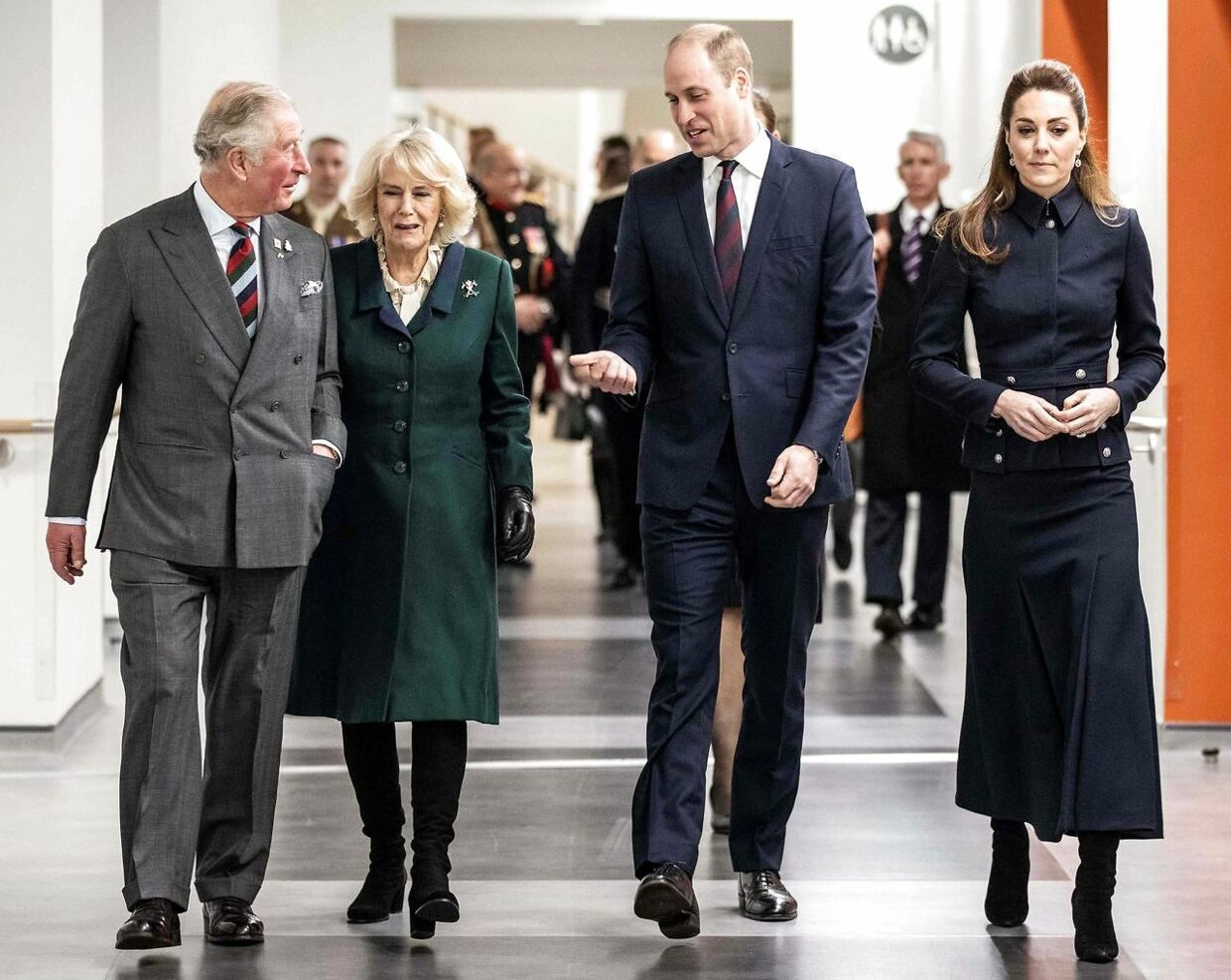 Britain's Prince William, Duke of Cambridge (2R) and his wife Britain's Catherine, Duchess of Cambridge (R) talk with his father Britain's Prince Charles, Prince of Wales (L) and his wife Britain's Camilla, Duchess of Cornwall (2L) during their visit to the Defence Medical Rehabilitation Centre (DMRC) in Loughborough, central England on February 11, 2020. - The DMRC currently provides services to a small group of veterans in the form of the Complex Prosthetic Assessment Clinic (CPAC), which is a joint MOD and NHS England commissioned outpatient clinic. (Photo by Richard Pohle / POOL / AFP)