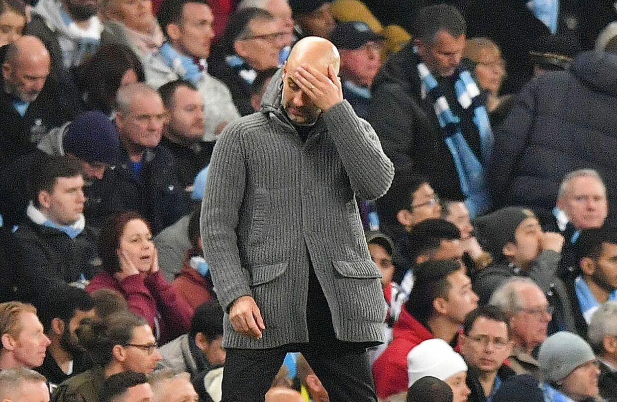 (FILES) In this file photo taken on April 17, 2019 Manchester City's Spanish manager Pep Guardiola reacts during the UEFA Champions League quarter final second leg football match between Manchester City and Tottenham Hotspur at the Etihad Stadium in Manchester, north west England. - Manchester City said they would appeal to the Court of Arbitration for Sport after being hit with a two-season ban from European competition on Friday, February 14. (Photo by Anthony Devlin / AFP)