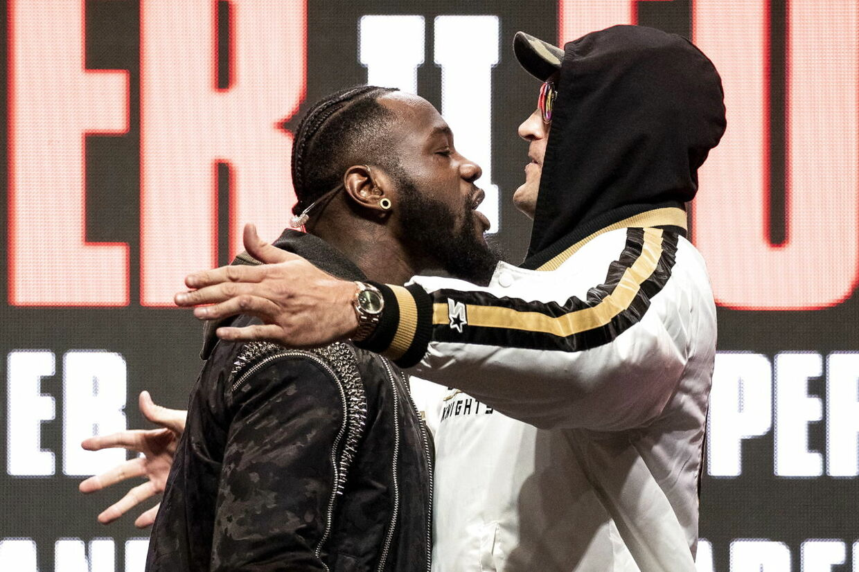 epa08229324 Heavyweight US boxer Deontay Wilder (L) and heavyweight British boxer Tyson Fury face off on stage during their last press conference before their rematch for the WBC Heavyweight World Championship at the Garden Arena in Las Vegas, Nevada, USA, 19 February 2020. The WBC Heavyweight World Championship fight between Wilder and Fury is schedule on February 22. EPA/ETIENNE LAURENT
