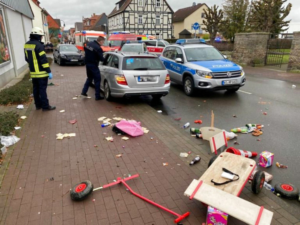 People react at the scene after a car ploughed into a carnival parade injuring several people in Volkmarsen, Germany February 24, 2020. ATTENTION:NUMBER PLATE WAS PIXELATED FROM SOURCE. Elmar Schulten/Waldeckische Landeszeitung via REUTERS.NO RESALES.NO ARCHIVES
