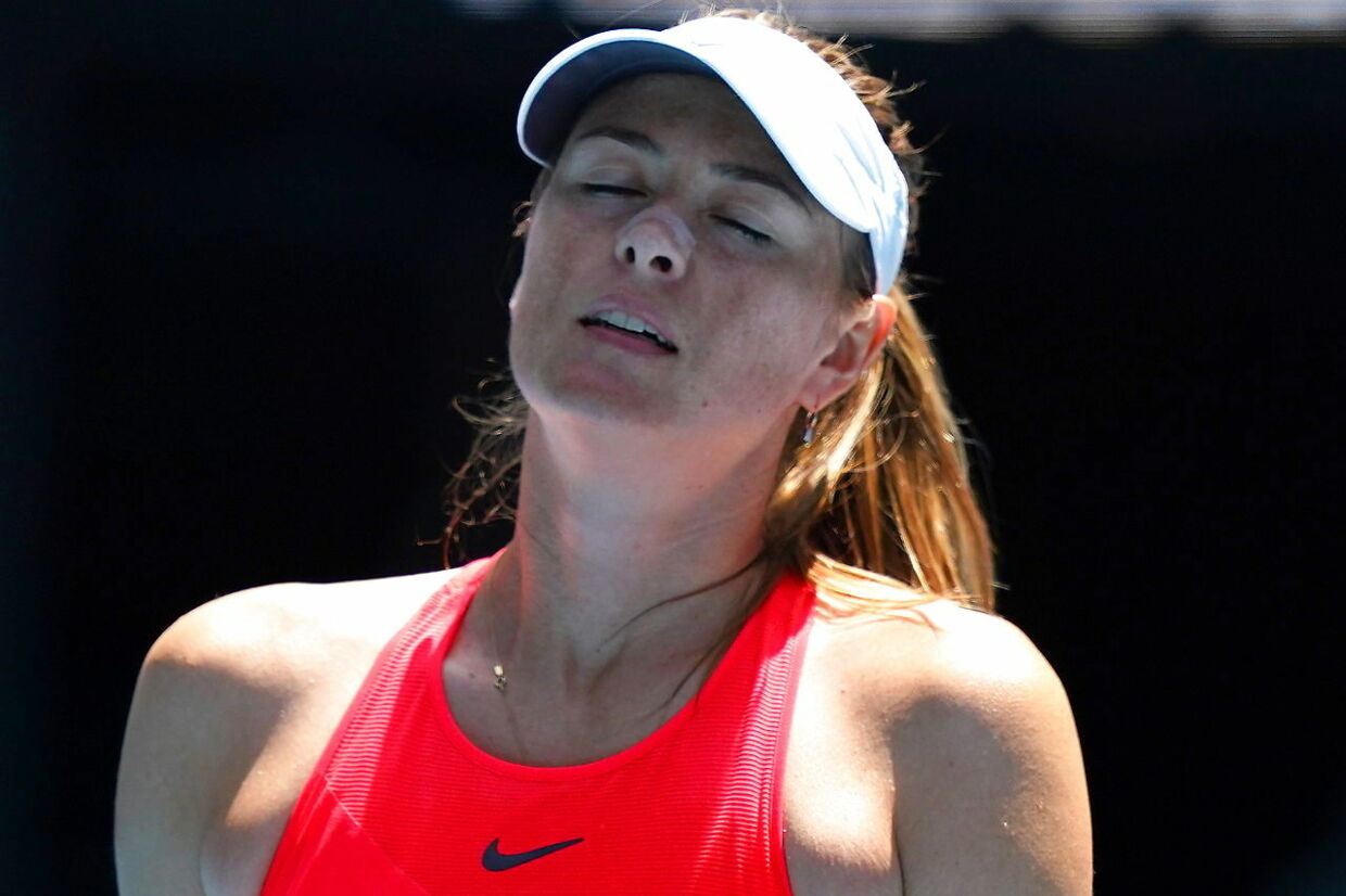 epa08146040 Maria Sharapova of Russia reacts while playing against Donna Vekic of Croatia on day two of the Australian Open tennis tournament during a first round match on day two of the Australian Open tennis tournament at Melbourne Park in Melbourne, Australia, 21 January 2020. EPA/SCOTT BARBOUR AUSTRALIA AND NEW ZEALAND OUT EDITORIAL USE ONLY