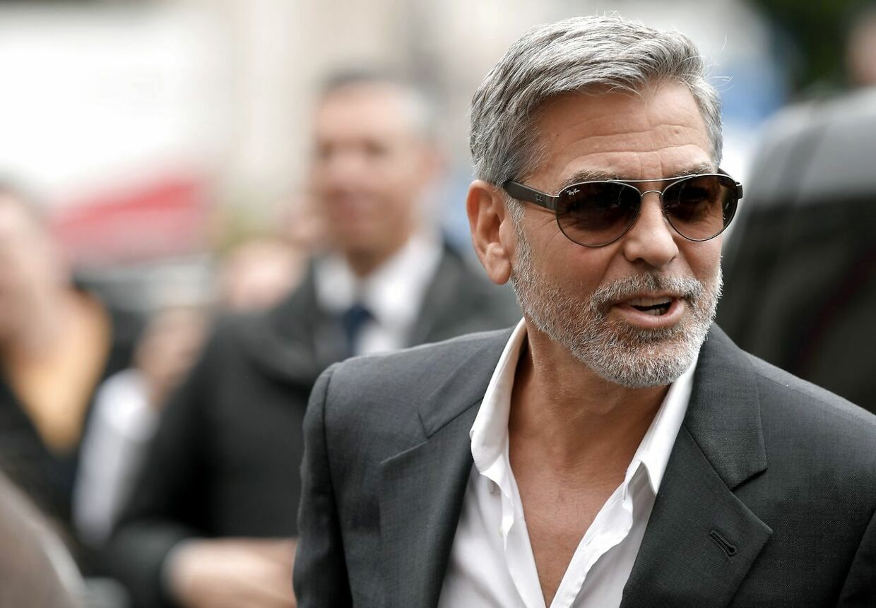 (FILES) In this file photo taken on May 13, 2019 US actor and film director George Clooney poses during a photocall of the Catch-22 TV show in Rome. - Hollywood star and activist George Clooney on June 11, 2019 urged the international community to go after illicit money from Sudan, voicing hope that financial pressure would change the calculus for generals who violently put down pro-democracy protests. Clooney - - a longtime campaigner for human rights in Sudan's western region of Darfur - - noted that the notorious Janjaweed militias were involved both in abuses in Darfur and in putting down demonstrations last week. (Photo by Tiziana FABI / AFP)