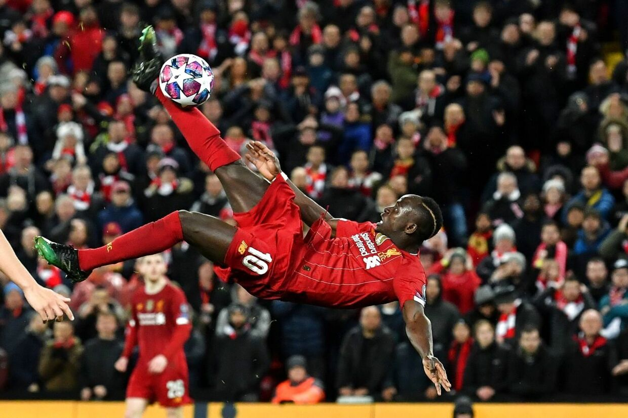 Liverpool's Senegalese striker Sadio Mane's bicycle kick goes over the bar during the UEFA Champions league Round of 16 second leg football match between Liverpool and Atletico Madrid at Anfield in Liverpool, north west England on March 11, 2020. (Photo by Paul ELLIS / AFP)