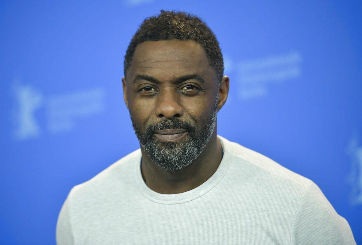 """British actor, director and executive producer Idris Elba poses during a photo call for the film """"Yardie"""" shown in the """"Panorama Special"""" category during the 68th edition of the Berlinale film festival in Berlin on February 22, 2018. Stefanie LOOS / AFP"""