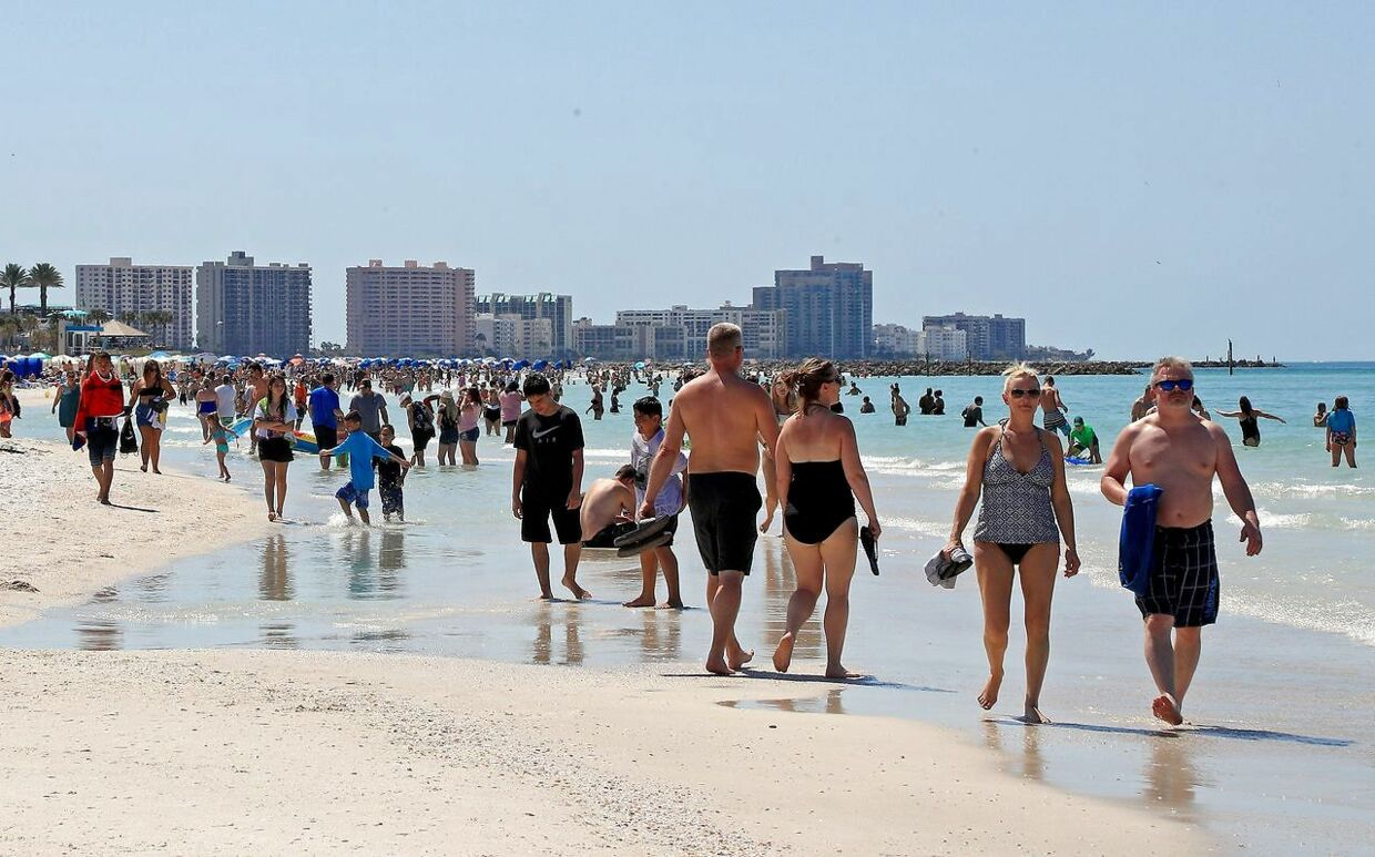 CLEARWATER, FL - MARCH 18: People gather on Clearwater Beach during spring break despite world health officials' warnings to avoid large groups on March 18, 2020 in Clearwater, Florida. The World Health Organization declared COVID-19 a global pandemic on March 11. Mike Ehrmann/Getty Images/AFP == FOR NEWSPAPERS, INTERNET, TELCOS & TELEVISION USE ONLY ==