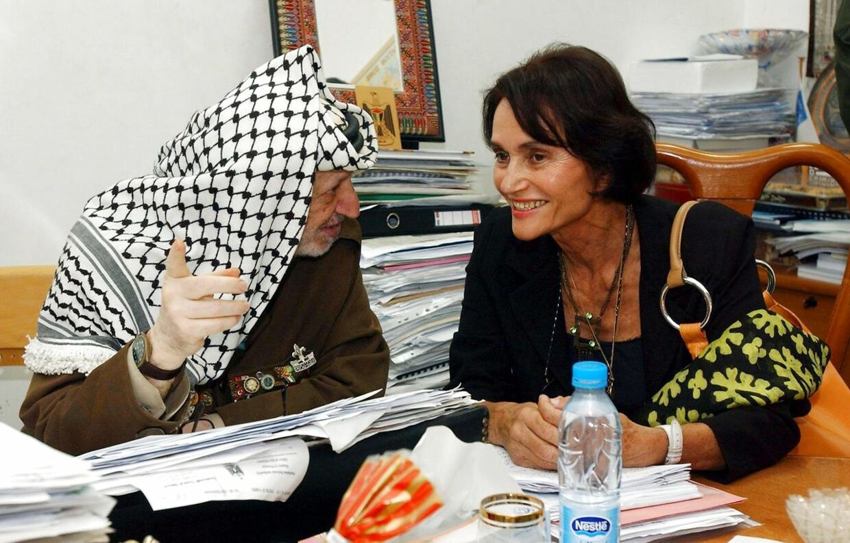 In this handout picture released by the Palestinian Authority's press office (PPO), Palestinian leader Yasser Arafat talks to Spanish Princess Maria Teresa of Bourbon during their meeting at his office in the West Bank city of Ramallah 25 August 2004. The cousin of Spain's King Juan Carlos is on a private visit to the Palestinian territories. AFP PHOTO/HO/PPO. HUSSEIN HUSSEIN / PPO / AFP