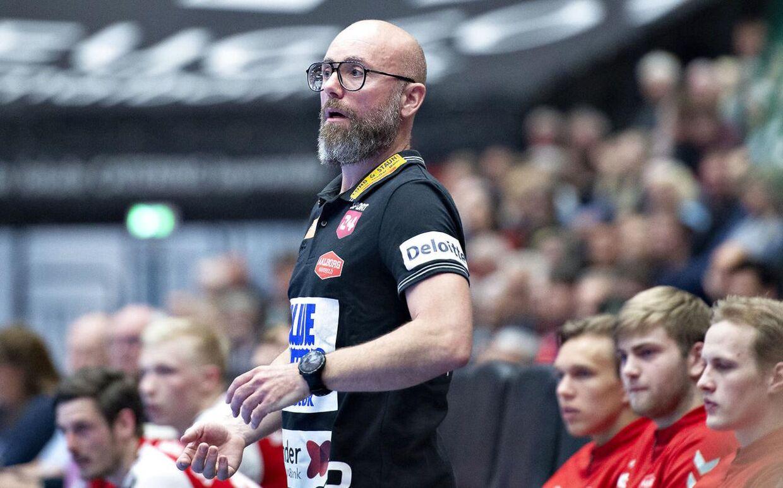 Stefan Madsens Aalborg-mandskab bliver kåret til dansk mester i herreligaen, da nordjyderne lå nummer et, da al spil blev suspenderet.