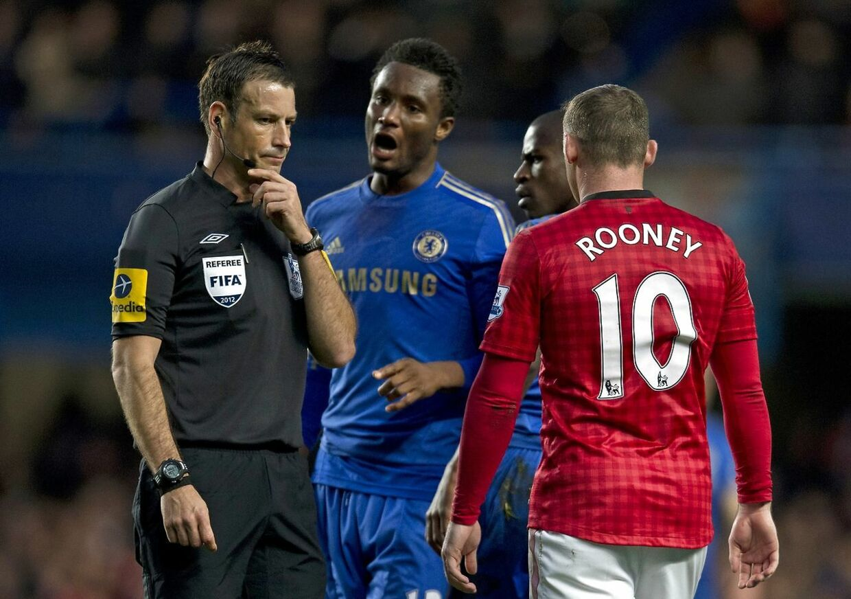 "A file picture taken on October 28, 2012 shows Chelsea's Nigerian midfielder John Mikel Obi (2nd L) talking with referee Mark Clattenburg (L) during the English Premier League football match between Chelsea and Manchester United at Stamford Bridge in London. London's Metropolitan Police have confirmed that they have received a complaint about allegedly racist comments made by a top flight referee during last weekend's match between Chelsea and Manchester United. Clattenburg is alleged to have used ""inappropriate language"", reportedly of a racist nature, towards Chelsea's Nigerian and Spanish players John Mikel Obi and Juan Mata at Stamford Bridge on October 28, 2012. AFP PHOTO/ADRIAN DENNIS RESTRICTED TO EDITORIAL USE.No use with unauthorized audio, video, data, fixture lists, club/league logos or ""live"" services. Online in-match use limited to 45 images, no video emulation.No use in betting, games or single club/league/player publications."