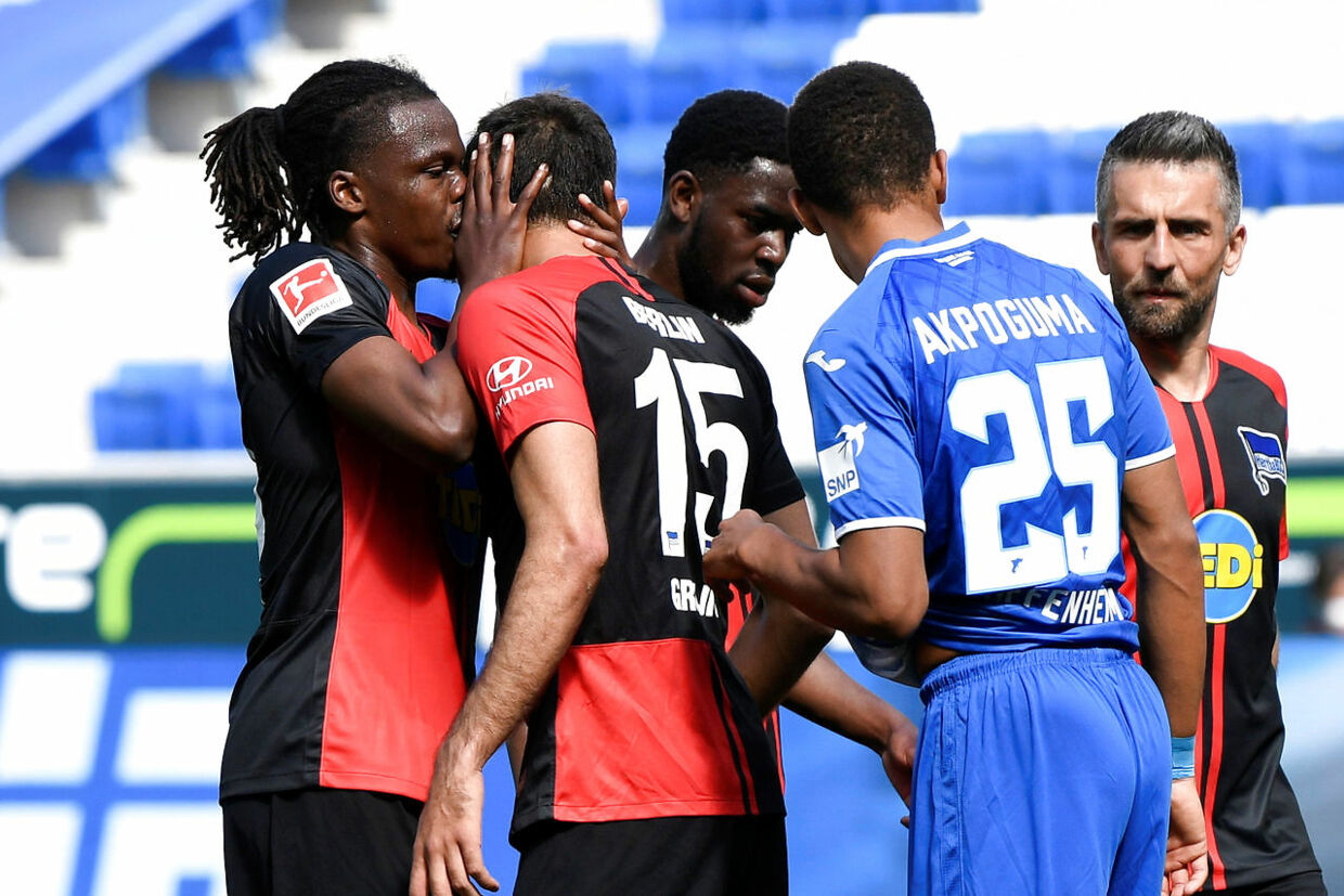 Soccer Football - Bundesliga - TSG 1899 Hoffenheim v Hertha BSC - PreZero Arena, Sinsheim, Germany - May 16, 2020 Hertha Berlin's Dedryck Boyata with Marko Grujic, as play resumes behind closed doors following the outbreak of the coronavirus disease (COVID-19) Thomas Kienzle/Pool via REUTERS DFL regulations prohibit any use of photographs as image sequences and/or quasi-video