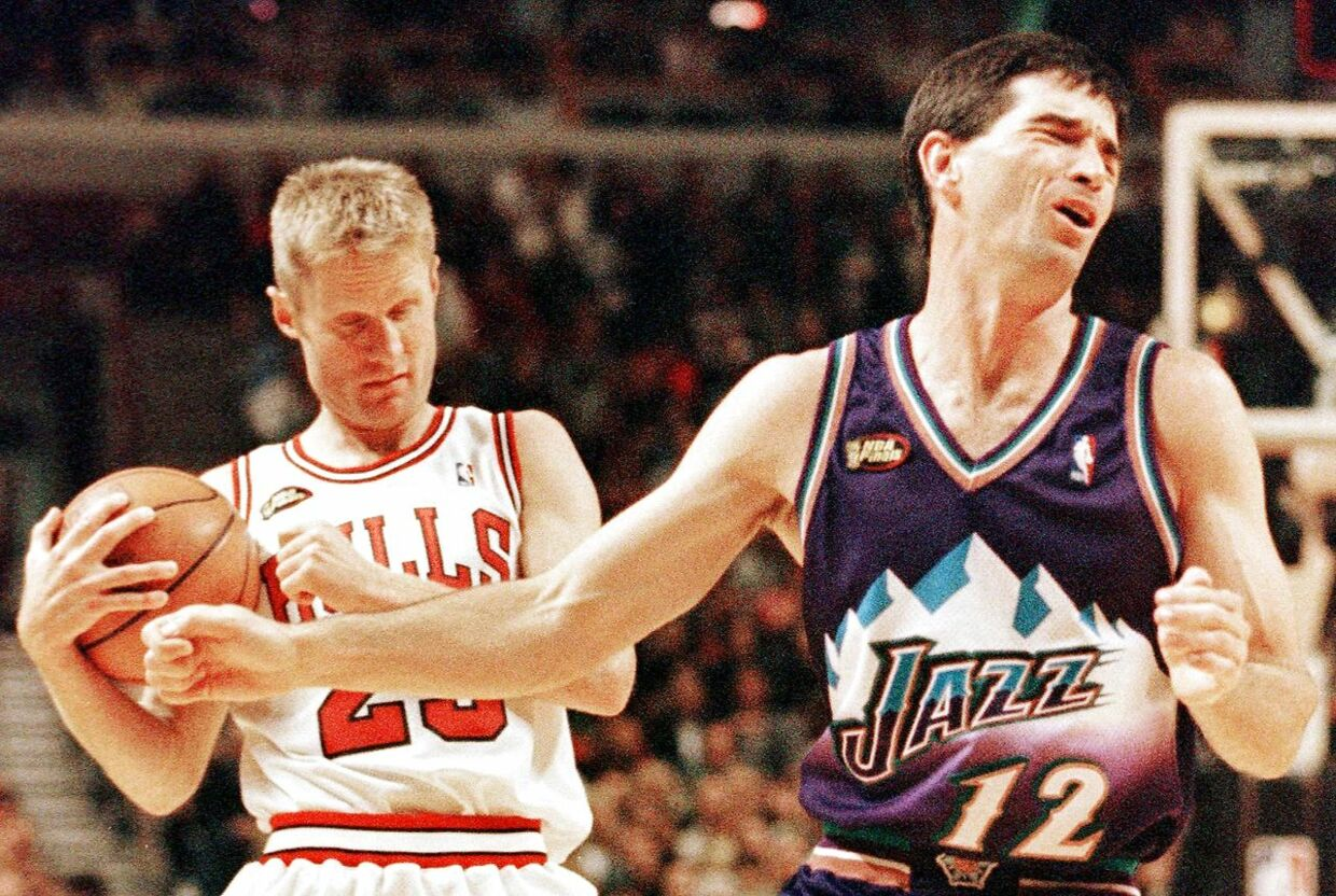 John Stockton (R) of the Utah Jazz reacts to being called for a foul on Steve Kerr (L) of the Chicago Bulls 07 June in game three of the NBA Finals at the United Center in Chicago, IL. The Bulls won the game 96-54 to lead the best-of-seven series 2-1.    AFP PHOTO/Jeff HAYNES JEFF HAYNES / AFP