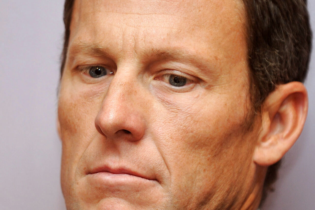 This photo taken on February 28, 2011 shows then seven-time Tour de France winner Lance Armstrong attending a press conference in Los Angeles to announce he will serve as co-chair for a campaign seeking to raise more than 600 million USD annually for cancer research in California. Lance Armstrong has agreed to pay $5 million in order to settle his looming federal fraud case stemming from his use of performance-enhancing drugs during the Tour de France, US media reported on April 19, 2018. The former cycling superstar was due to face a trial next month over claims that he defrauded the US government when he doped while racing for his United States Postal Service-sponsored team. / AFP PHOTO / Gabriel BOUYS
