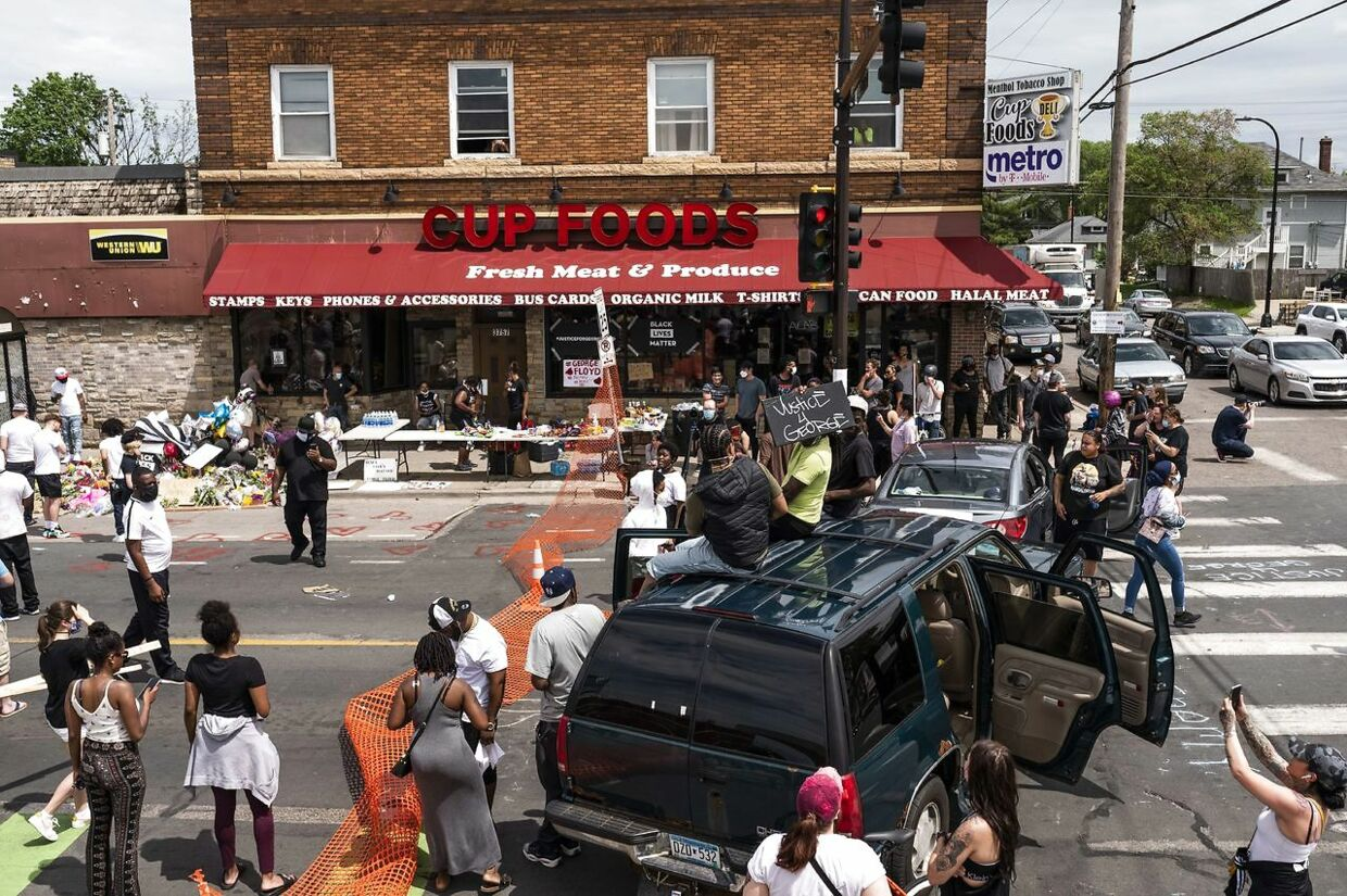 MINNEAPOLIS, MN - MAY 27: Protesters gather outside the Cup Foods on Chicago Avenue and 38th Street on May 27, 2020 in Minneapolis, Minnesota. The intersection has become the site of an ongoing protest after the police killing of George Floyd. Stephen Maturen/Getty Images/AFP == FOR NEWSPAPERS, INTERNET, TELCOS & TELEVISION USE ONLY ==