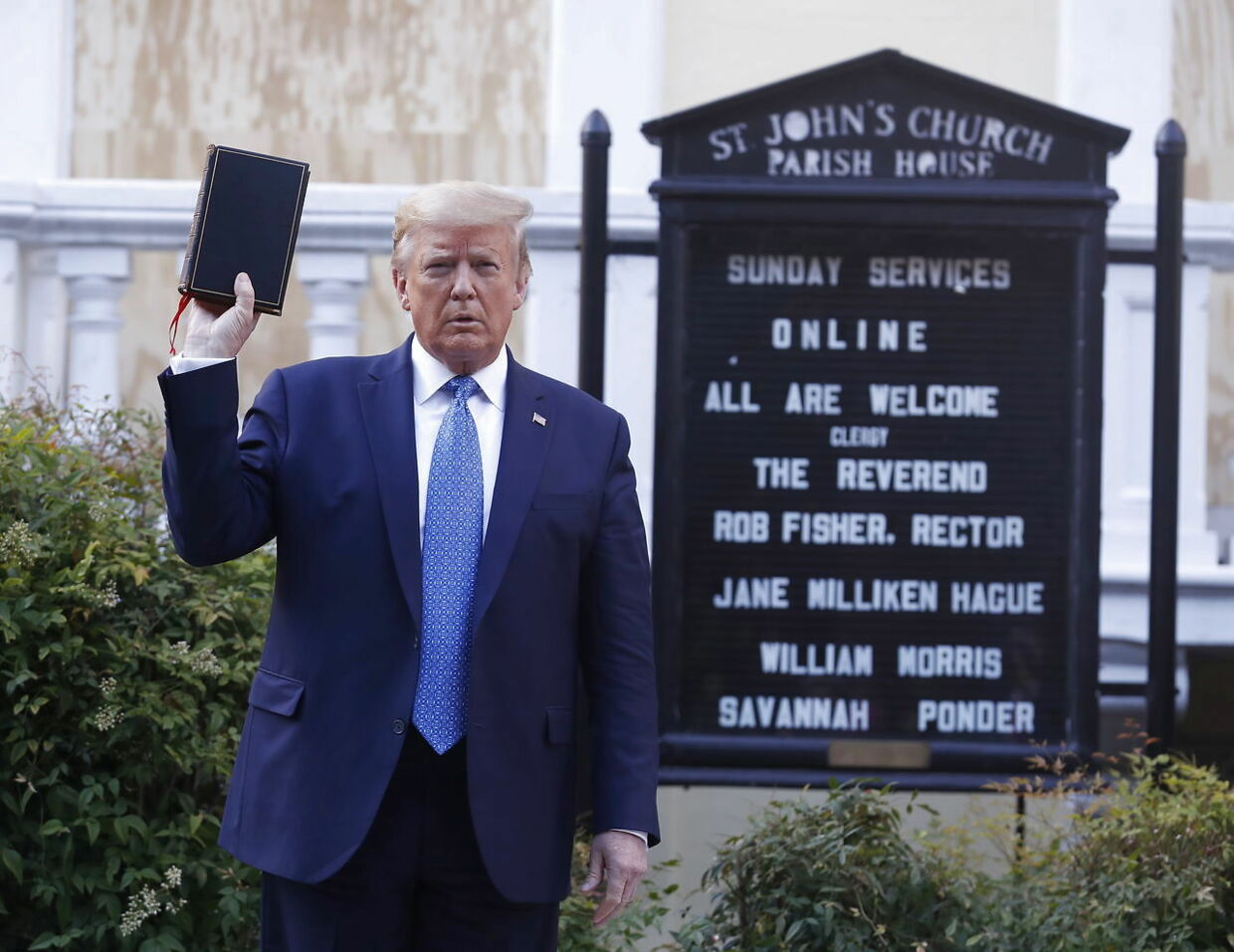 epaselect epa08459173 US President Donald J. Trump poses with a bible outside St. John's Episcopal Church after delivering remarks in the Rose Garden at the White House in Washington, DC, USA, 01 June 2020. Trump addressed the nationwide protests following the death of George Floyd in police custody. EPA/SHAWN THEW