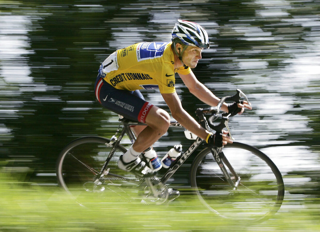 Then overall leader and five-time Tour de France winner US Postal rider Lance Armstrong of the U.S. cycles down a mountain during the 204.5 km long 17th stage of the Tour de France from Bourg-d'Oisans to Le Grand Bornand, in this July 22, 2004 file photo. Armstrong has been stripped of his seven Tour de France titles and banned for life after the International Cycling Union (UCI) said on October 22, 2012 it had ratified the United States Anti-Doping Agency's (USADA) sanctions. REUTERS/Stefano Rellandini/Files (FRANCE - Tags: SPORT CYCLING PROFILE DRUGS SOCIETY)
