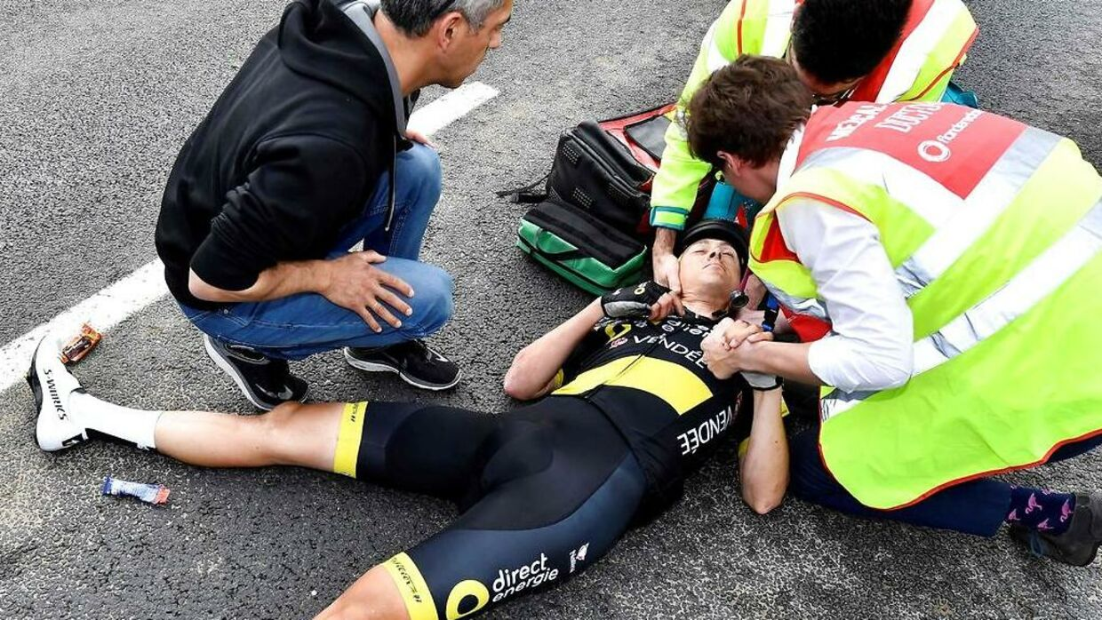 Dutch Niki Terpstra of Direct Energie lies on the ground after falling during the 103rd edition of the 'Ronde van Vlaanderen - Tour des Flandres - Tour of Flanders' one day cycling race, 270, 1km from Antwerp to Oudenaarde, on April 7, 2019. (Photo by DIRK WAEM / BELGA / AFP) / Belgium OUT
