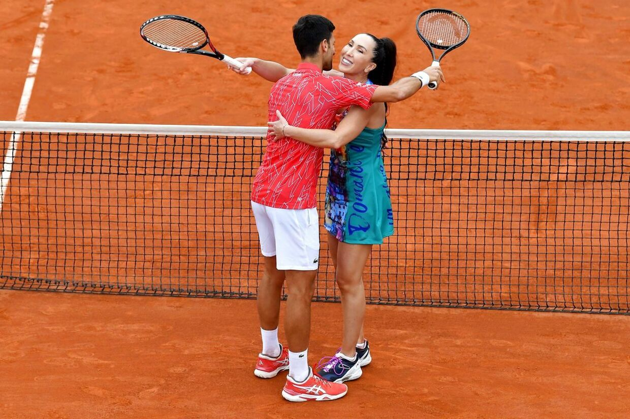 (FILES) In this file photo taken on June 12, 2020 Serbia's Novak Djokovic hugs Jelena Jankovic during a tennis doubles against Serbia's Nenad Zimonjic and Olga Danilovic during a charity exhibition hosted by Novak Djokovic, in Belgrade. - Novak Djokovic has also tested positive for coronavirus on June 23, 2020 along with Grigor Dimitrov, Borna Coric and Viktor Troicki, after taking part in an exhibition tennis tournament in the Balkans featuring world number one Novak Djokovic, raising questions over the sport's planned return in August. (Photo by Andrej ISAKOVIC / AFP)