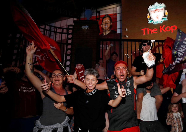 Soccer Football - Premier League - Liverpool fans celebrate winning the Premier League - Liverpool, Britain - June 25, 2020 Liverpool fans celebrate winning the Premier League outside Anfield after Chelsea won their match against Manchester City REUTERS/Phil Noble