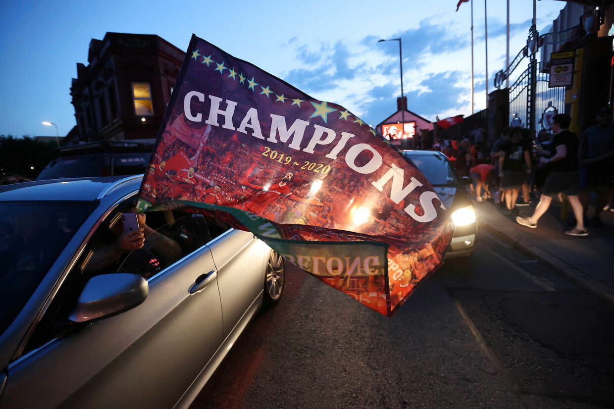 Soccer Football - Liverpool fans celebrate winning the Premier League - Liverpool, Britain - June 25, 2020 Liverpool fans celebrate winning the Premier League outside Anfield after Chelsea won their match against Manchester City Action Images via Reuters/Carl Recine
