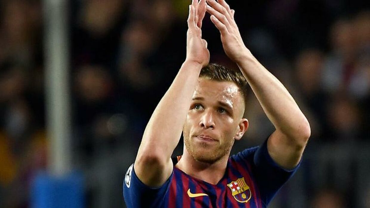 Barcelona's Brazilian midfielder Arthur acknowledges the public as he leaves the pitch during the UEFA Champions League quarter-final second leg football match between Barcelona and Manchester United at the Camp Nou stadium in Barcelona on April 16, 2019. LLUIS GENE / AFP