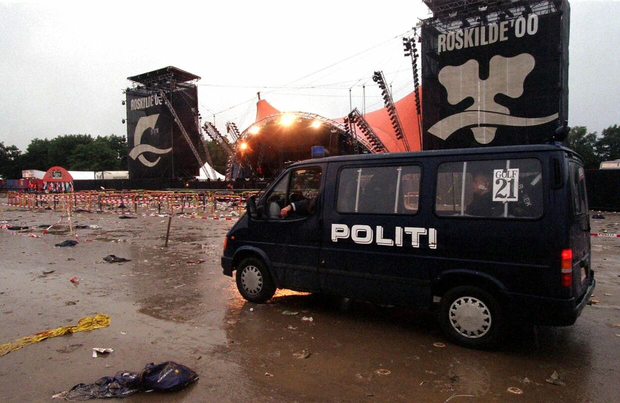 A police van patrols the grounds of the Roskilde music festival Saturday 01 July 2000 following a fatal incident here. The festival in western Denmark was hit late 30 June by the first tragedy in its 30-year history when eight people were crushed and trampled to death in a crowd surge as American group Pearl Jam were playing on the main stage. Eight people were crushed and trampled to death, including at least one foreign national. JENS NOERGAARD LARSEN / SCANPIX DENMARK / AFP