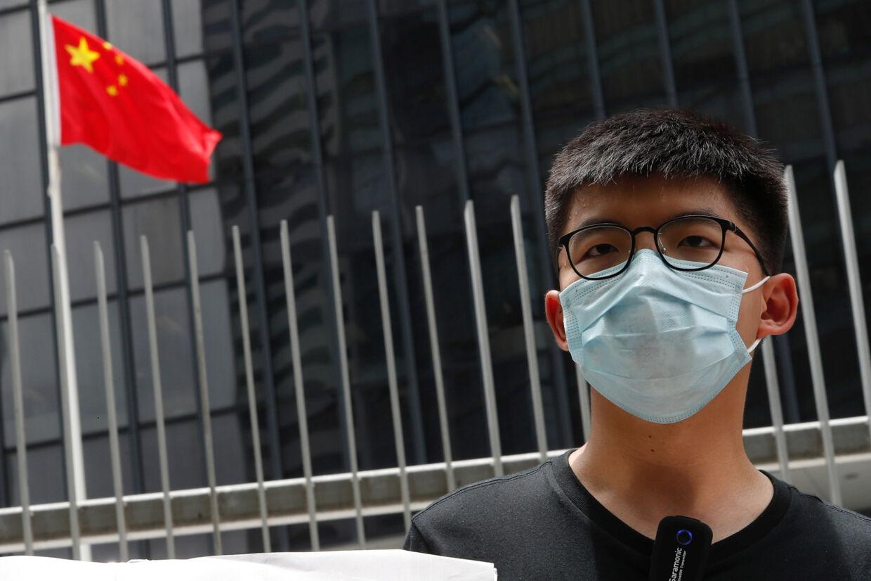 Den fremtrædende aktivist Joshua Wong er blandt de forfattere, hvis bøger ikke længere er til udlån på Hongkongs biblioteker. Tyrone Siu/Reuters