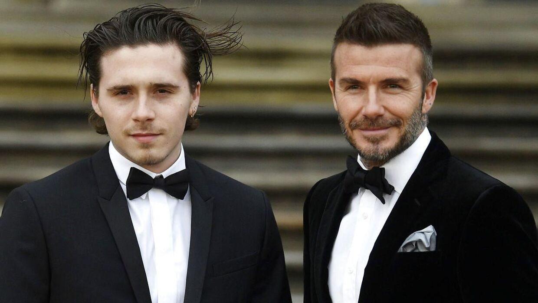 Brooklyn Beckham ved siden af sin fodbold-far David Beckham til verdenspremieren på 'Our Planet' på Natural History Museum i London i april 2019.