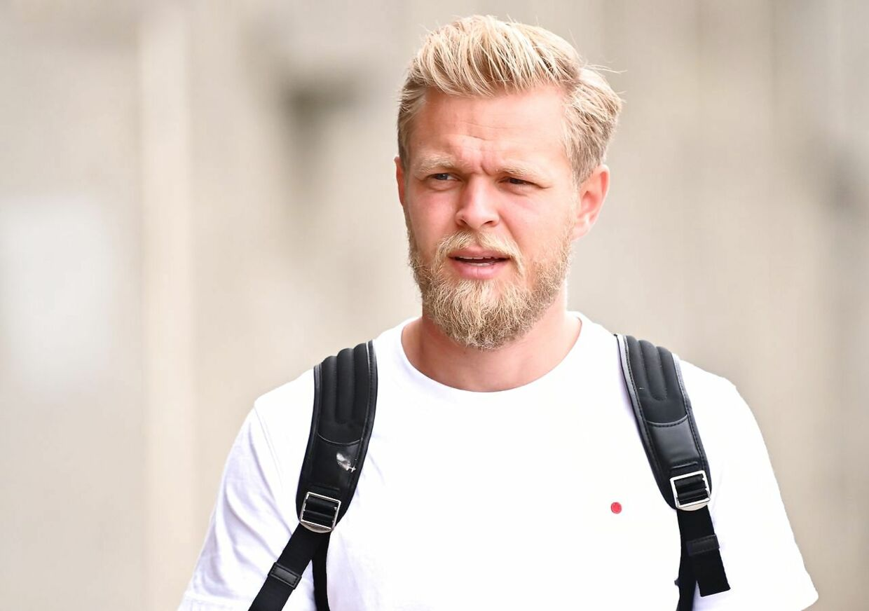 Haas F1's Danish driver Kevin Magnussen arrives in the paddock during the previews ahead of the Formula One Hungarian Grand Prix at the Hungaroring circuit in Mogyorod near Budapest, Hungary, on July 16, 2020. (Photo by JOE KLAMAR / AFP)