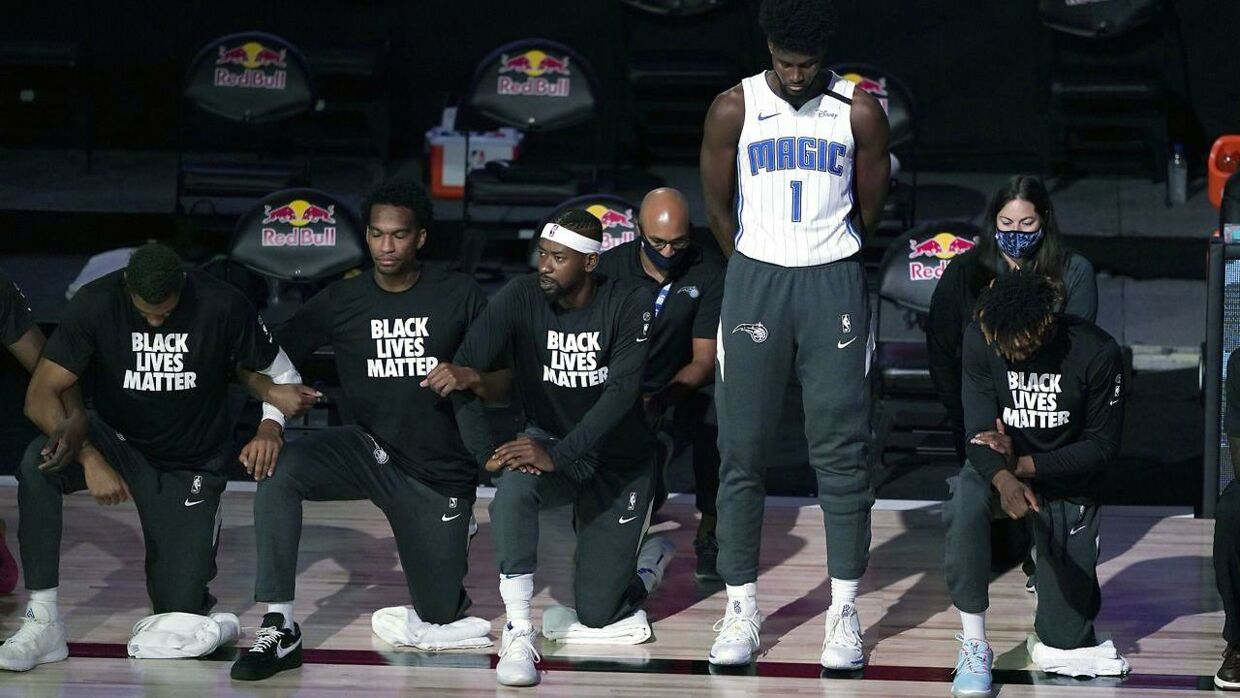 Orlando, FL - JULY 31: Jonathan Isaac #1 of the Orlando Magic stands as others kneel before the start of a game between the Brooklyn Nets and the Orlando Magic on July 31, 2020 at The HP Field House at ESPN Wide World Of Sports Complex in Orlando, Florida. NOTE TO USER: User expressly acknowledges and agrees that, by downloading and/or using this Photograph, user is consenting to the terms and conditions of the Getty Images License Agreement. Ashley Landis - Pool/Getty Images/AFP == FOR NEWSPAPERS, INTERNET, TELCOS & TELEVISION USE ONLY ==