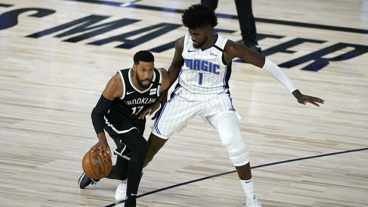 July 31, 2020; Lake Buena Vista, USA; Brooklyn Nets' Garrett Temple (17) dribbles as Orlando Magic's Jonathan Isaac (1) defends during the first half of an NBA basketball game. Mandatory Credit: Ashley Landis/Pool Photo via USA TODAY Sports