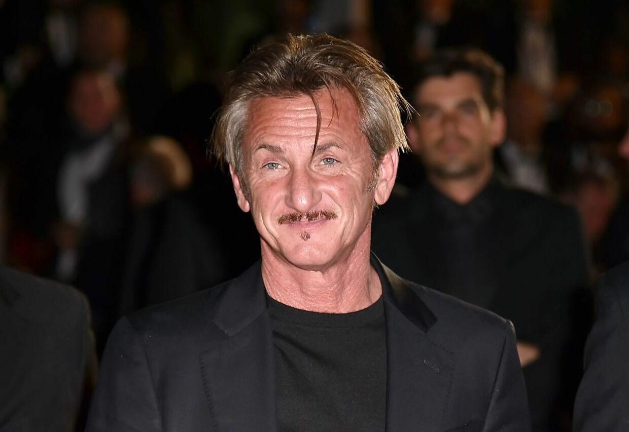 """(FILES) In this file photo taken on May 20, 2016 US actor and director Sean Penn leaves the Festival Palace after the screening of the film """"The Last Face"""" at the 69th Cannes Film Festival in Cannes, southern France. - Two-time Oscar winner Sean Penn has sparked controversy with his latest comments about the #MeToo movement, saying in an interview aired September 17, 2018 that he was """"very suspicious"""" of a campaign that had divided men and women. Penn, who appeared on NBC's """"Today"""" program to promote his television debut on Hulu's """"The First, """" said the popular debate was """"too black and white"""" and had been at times too quick to pass judgment on the accused. (Photo by ALBERTO PIZZOLI / AFP)"""