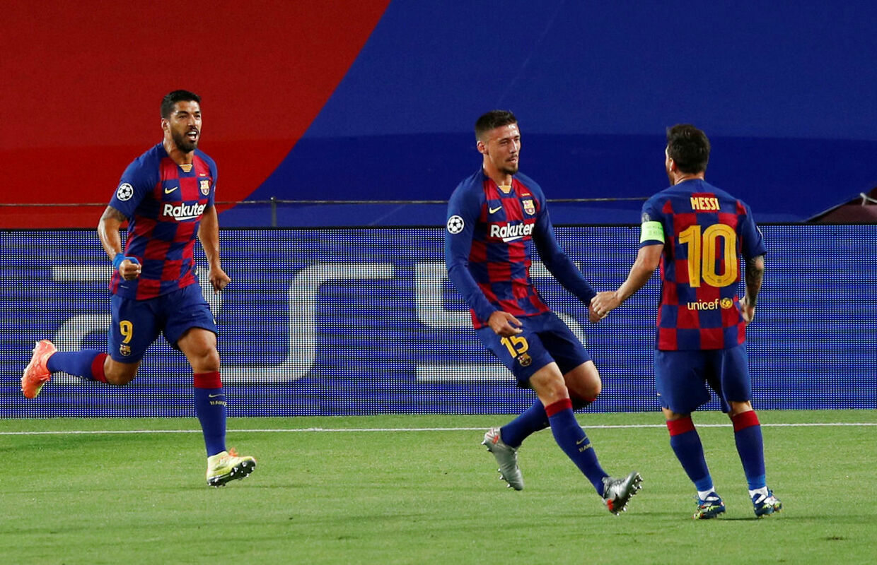Soccer Football - Champions League - Round of 16 Second Leg - FC Barcelona v Napoli - Camp Nou, Barcelona, Spain - August 8, 2020 Barcelona's Clement Lenglet celebrates scoring their first goal with Lionel Messi and Luis Suarez, as play resumes behind closed doors following the outbreak of the coronavirus disease (COVID-19) REUTERS/Albert Gea