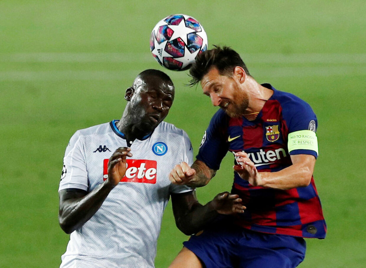 Soccer Football - Champions League - Round of 16 Second Leg - FC Barcelona v Napoli - Camp Nou, Barcelona, Spain - August 8, 2020 Barcelona's Lionel Messi in action with Napoli's Kalidou Koulibaly, as play resumes behind closed doors following the outbreak of the coronavirus disease (COVID-19) REUTERS/Albert Gea