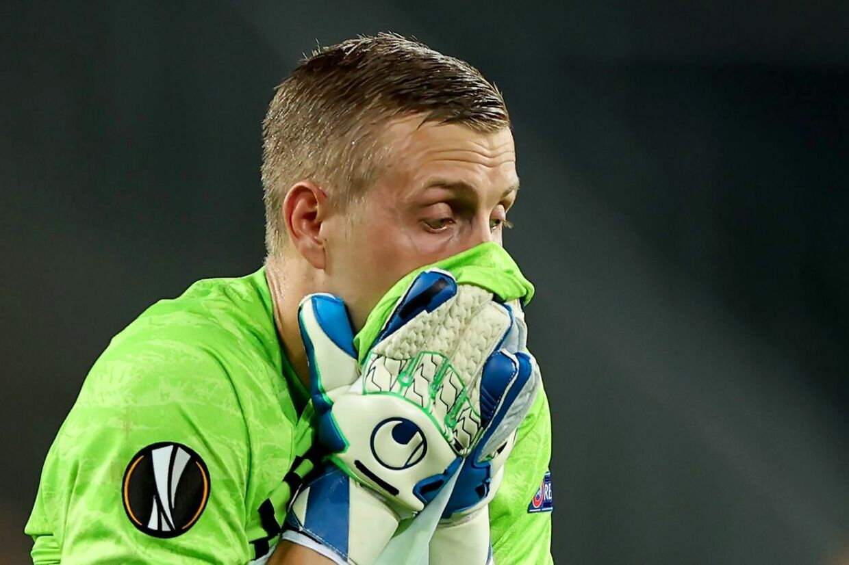 FC Copenhagen's Swedish goalkeeper Karl-Johan Johnsson reacts during the UEFA Europa League quarter-final football match between Manchester United and FC Copenhagen at the RheinEnergieStadion, in Cologne, western Germany, on August 10, 2020. (Photo by WOLFGANG RATTAY / POOL / AFP)