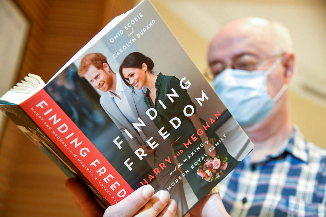 An employee holds a copy of 'Finding Freedom', an unofficial biography on Prince Harry and Meghan Markle, the Duke and Duchess of Sussex, at a Waterstones bookshop in London, Britain August 12, 2020. REUTERS/Toby Melville