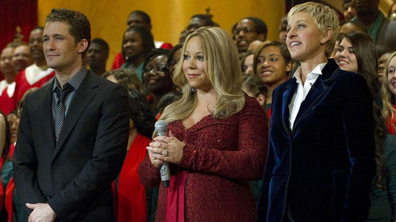 Arkivfoto af Mariah Carey (forrest i midten) og Ellen DeGereners (forrest til højre) under et Obama-event i 2010.