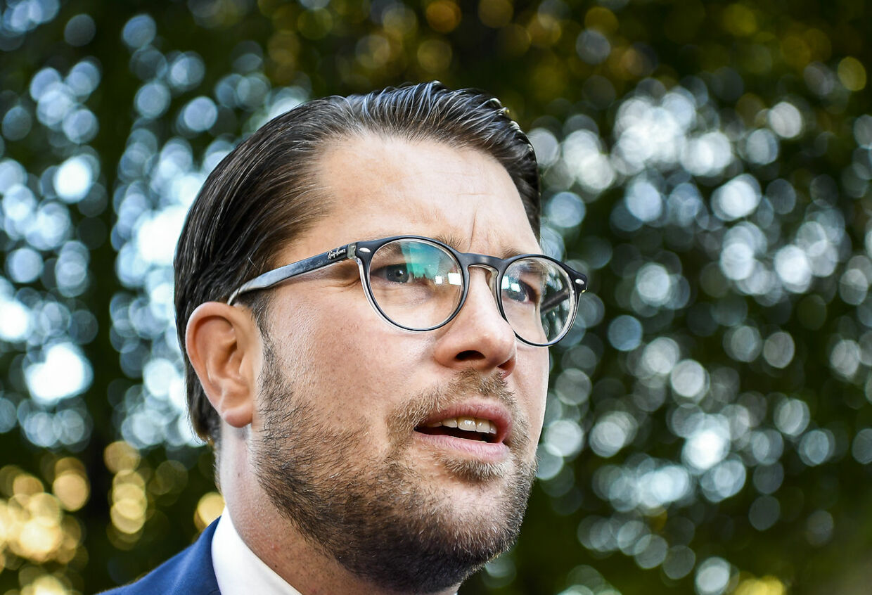 The party leader of the far-right Sweden Democrats, Jimmie Akesson, speaks to the press upon arrival to the opening of the Swedish Parliament Riksdagen on September 25, 2018 in Stockholm. Sweden's centre-right opposition and the far-right ousted Lofven in a vote of no-confidence as expected after September 9 elections left neither the left or right bloc with a majority. A total of 204 of 349 members of parliament voted against Lofven, while 142 voted in favour of him. Jonathan NACKSTRAND / AFP