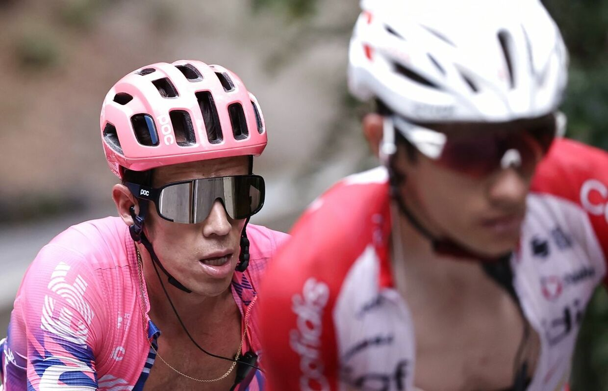 Team Education First rider Colombia's Rigoberto Uran (L) climbs during the 17th stage of the 107th edition of the Tour de France cycling race, 170 km between Grenoble and Meribel, on September 16, 2020. (Photo by KENZO TRIBOUILLARD / AFP)