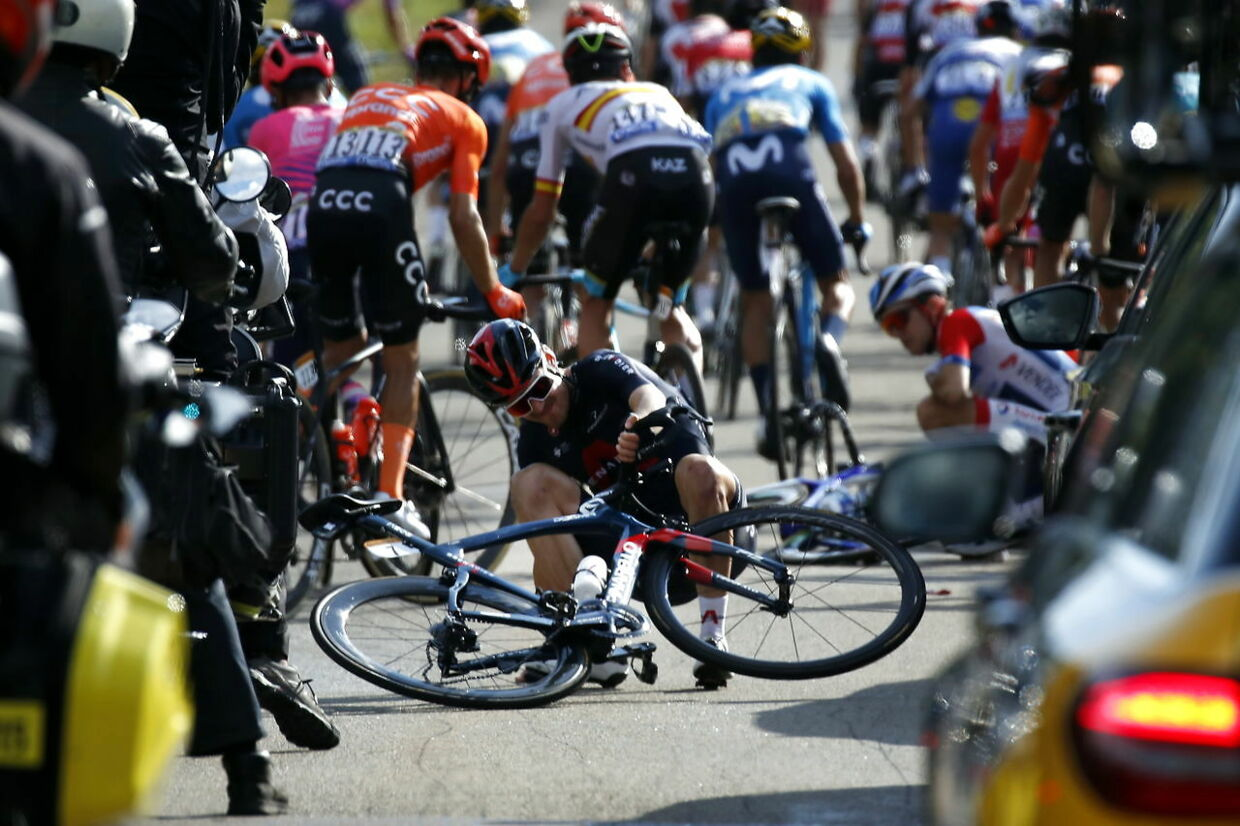 epa08678958 Russian rider Pavel Sivakov (C) of the Ineos Grenadiers team reacts after crashing during during the 19th stage of the 107th edition of the Tour de France cycling race over 166.5km from Bourg-en-Bresse to Champagnole, France, 18 September 2020. EPA/SEBASTIEN NOGIER