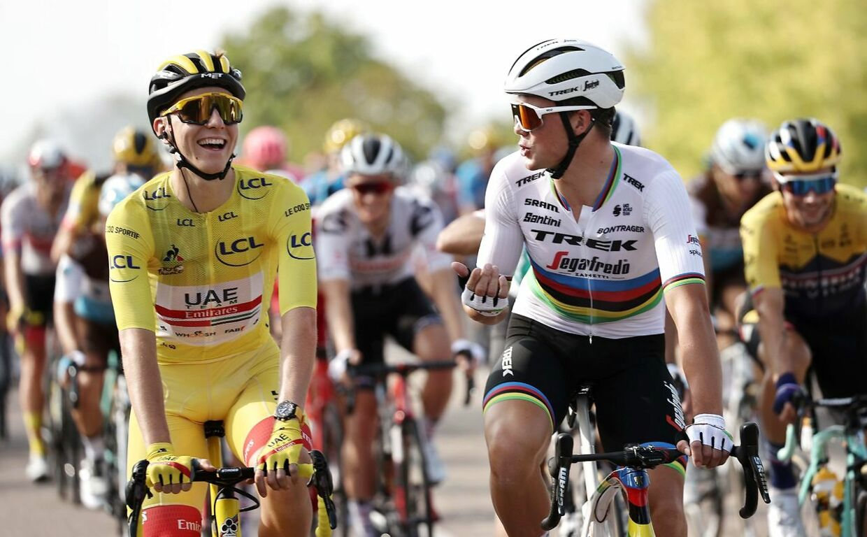 Team UAE Emirates rider Slovenia's Tadej Pogacar wearing the overall leader's yellow jersey rides with Team Trek rider Denmark's Mads Pedersen during the 21st and last stage of the 107th edition of the Tour de France cycling race, 122 km between Mantes-la-Jolie and Champs Elysees Paris, on September 20, 2020. (Photo by KENZO TRIBOUILLARD / AFP)