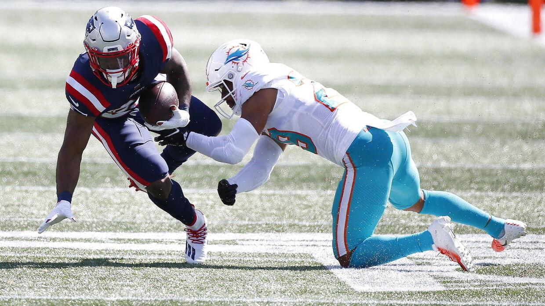 James White (tv.) var i sidste uge med for New England Patriots i sæsonens første kamp.