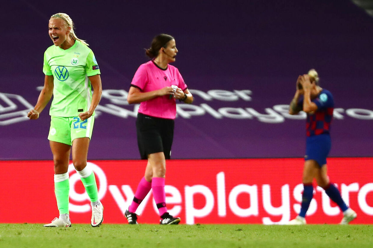VfL Wolfsburg's Danish forward Pernille Harder (L) celebrates her team's victory at the end of the UEFA Women's Champions League semi-final football match between VFL Wolfsburg and FC Barcelona at the Anoeta stadium in San Sebastian on August 25, 2020. (Photo by SERGIO PEREZ / POOL / AFP)