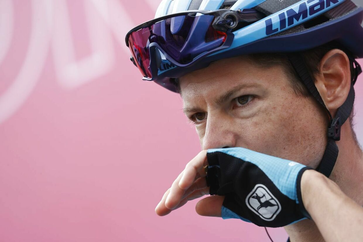 Team Astana rider Denmark's Jakob Fuglsang stands on the podium before the start of the 5th stage of the Giro d'Italia 2020 cycling race, a 140-kilometer route between Mileto and Camigliatello Silano, on October 7, 2020 in Mileto. (Photo by Luca Bettini / AFP)